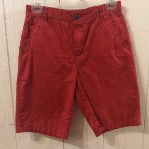 Boys red shorts.